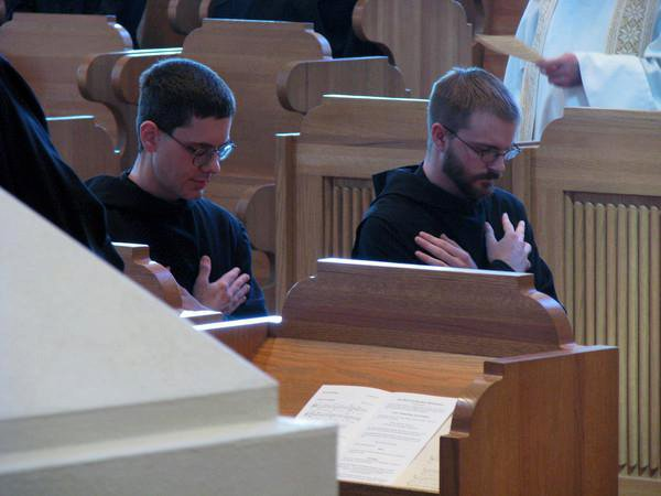 Two monks making vows at their religious profession